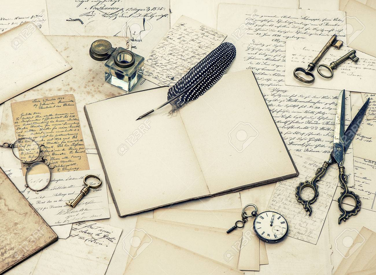 old letters, inkwell and vintage feather ink pen.
